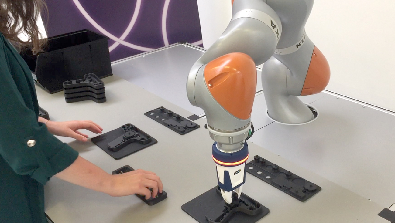 Person working with a robot, collaborative robotics