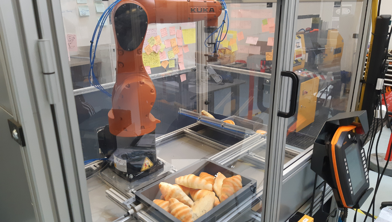 Bin Picking of Highly Variable Complex Shaped Parts case study image of robot picking croissants